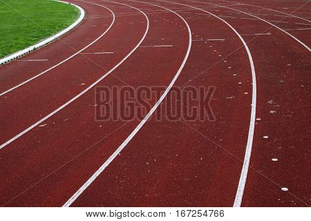 Abstract photo of  white stripes of a running track of 400 meter