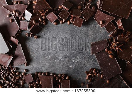 Coffee beans and dark chocolate. Chocolate bar . Background with chocolate. Coffee beans. A large bar of chocolate on gray abstract background.