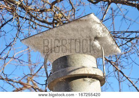 Winter season and seasonal specific. Ice Condensation Around Aluminum Asbestos Chimney
