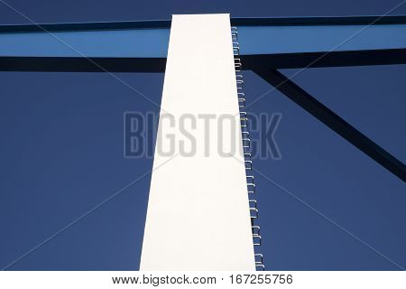 White, blue steel bridge sections of a bridge. abstract contrast color photo.