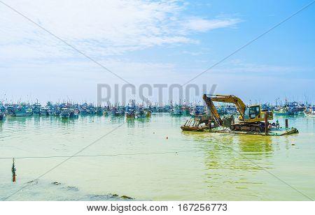 Excavator In Port