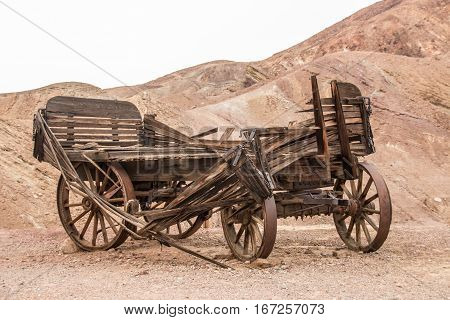 Old wooden broken wagon in calico ghost town USA