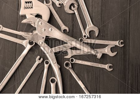 Many wrenches on black wooden pliers set adjustable wrenches Fix wrenches