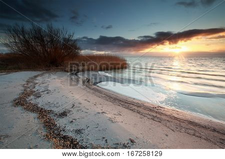beautiful sunset on Ijsselmeer beach Friesland Netherlands