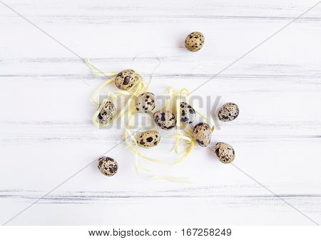 Easter Festive Background, Quail Eggs On A White Wooden Table. Flat Lay, Top View, Minimal Concept