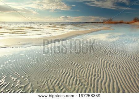 low tide on the big lake beach Ijsselmeer Netherlands