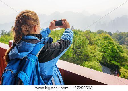 Closeup View Of Female Tourist Taking Photo Of Mountains