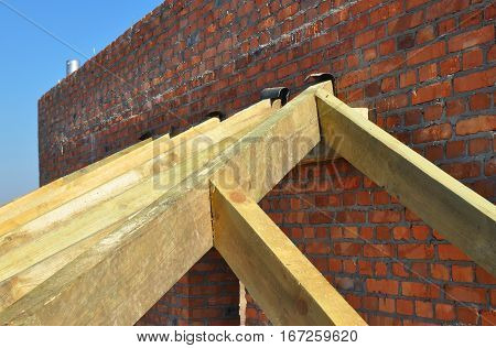Building timber roof trusses for new attic house construction. Timber roof truss. Roofing construction.