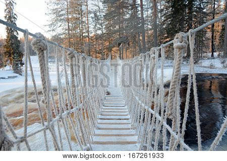Cable bridge under the waterfall near the Ruskeala kanyon, Karelia republic