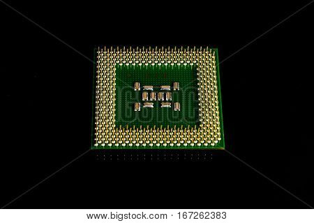 Close-up of computer chip in black backgroun.
