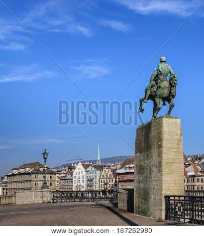Zurich, Switzerland - 27 January, 2017: view with the monument to Rudolf Brun in the foreground and old town buildings in the background. Zurich is the largest city in Switzerland and the capital of the Swiss canton of Zurich.