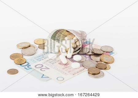 Conceptual Image: Polish Zloty And A Little Pills On The Light Background