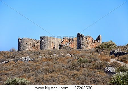 Windmill ruins on a hillside near Elounda Crete Greece Europe.
