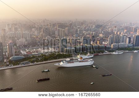 China Shanghai. View from the Oriental Pearl Tower in the old part of the city and the Bund Huangpu River. Ships on the river.