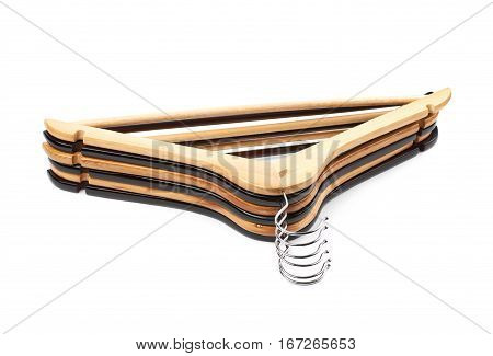 Pile of wooden hangers isolated over the white background