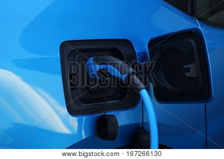 Electric car - charging on charge station - electro mobility environment friendly - copy space