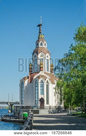 Orthodox temple on the waterfront against the blue sky in early spring