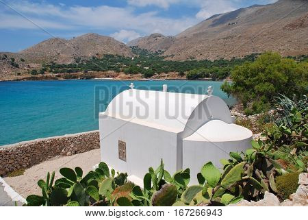 A small chapel above Pondamos beach at Emborio on the Greek island of Halki.