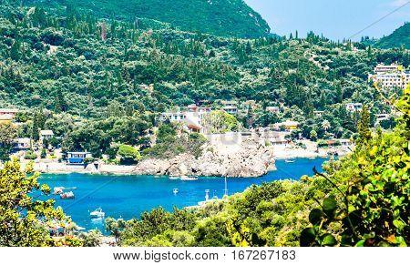 glimpse of a beach in Corfu with calm sea