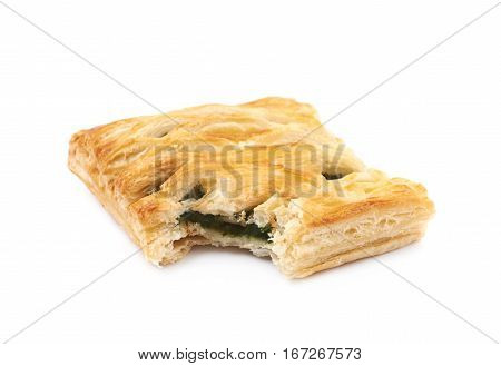 Spinach and cheese bun pastry with a bite taken off it, composition isolated over the white background