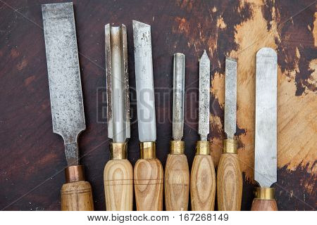 Old used wood lathe chisels selection on the wooden table
