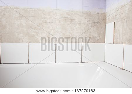 Home improvement: tiling bathroom walls; unfinished work