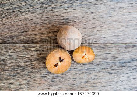 Fresh Sapodilla Fruits On Old Wooden Background