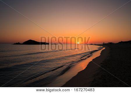 Su Giudeu island at sunrise Chia Sardinia Italy.