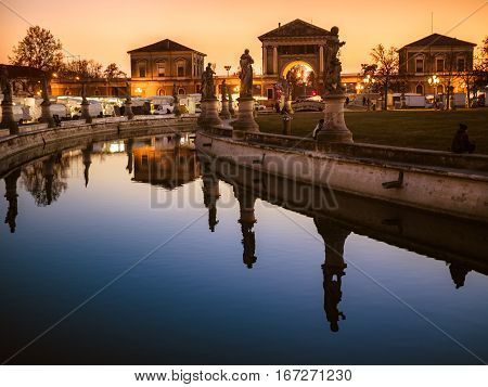Canal of Prato della Valle square at sunset Padua north Italy.