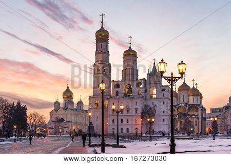 Ivan the Great Bell tower and Kremlin Cathedrals at winter sunset in Moscow