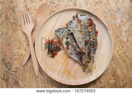 Mackerel spicy on wood dish. Asian food style