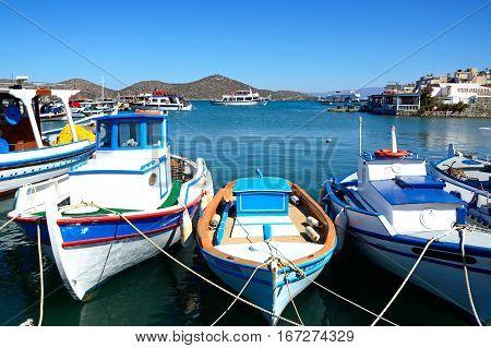ELOUNDA, CRETE - SEPTEMBER 17, 2016 - Traditional Greek fishing boats moored in the harbour Elounda Crete Greece Europe, September 17, 2016.