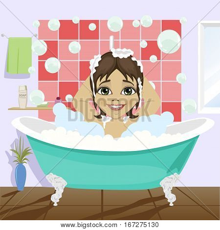 cute little girl washing her hair with shampoo sitting in bathtub in bathroom