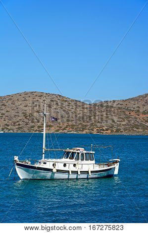 ELOUNDA, CRETE - SEPTEMBER 17, 2016 - Small yacht moored in the bay Elounda Crete Greece Europe, September 17, 2016.