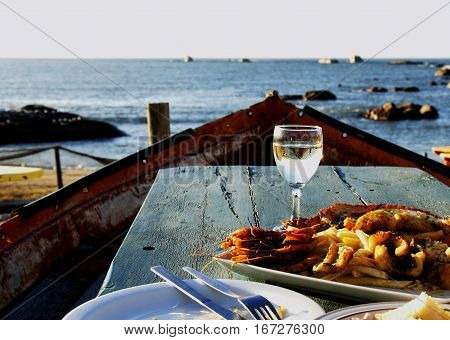 Glass Of White Wine And Plate Seafood, Selective Focus
