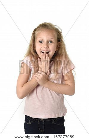 portrait of cute and sweet little girl in disbelief and surprise face expression looking amazed in schock with mouth opened isolated on white background