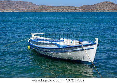 Small fishing boat moored in the bay Elounda Crete Greece Europe.