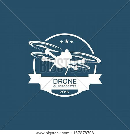 Drone quadcopter camera club emblem, logo. Great emblem design drones Icon. Vector iIllustration isolated on a blue background