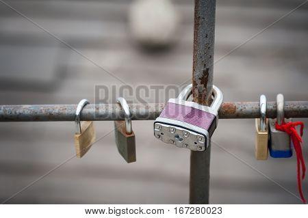 Purple wedding lock on iron gates in Italy