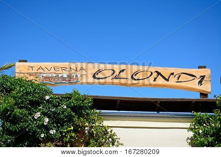 ELOUNDA, CRETE - SEPTEMBER 17, 2016 - Olondi taverna sign along the waterfront Elounda Crete Greece Europe, September 17, 2016.