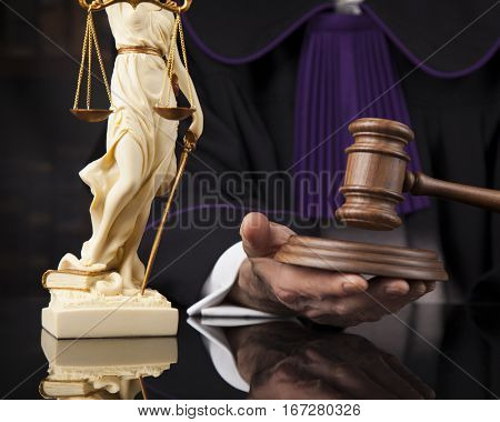 law theme, mallet of the judge, wooden desk, scales of justice