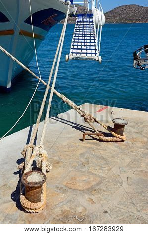 Boat moorings with ramp leading to the boat Elounda Crete Greece Europe.