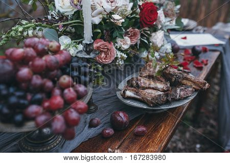 Wedding table with meat and flowers in nature. decoration