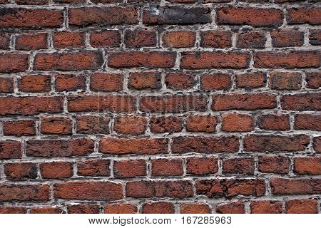 Colorful brick wall texture background. Between the bricks has a light mortar