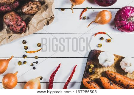 Unwashed Fresh Vegetables On A Light Wooden Table