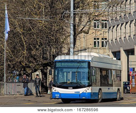 Zurich, Switzerland - 29 January, 2017: a Hess trolleybus turning to Bahnhofbrucke bridge. Hess is a brand of Carrosserie Hess AG, which is a Swiss bus, trolleybus and commercial vehicle manufacturer.