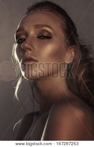 Glamour Portrait Of Young Fashion Woman Face With Bright Evening Golden Make Up For Party And Tanned