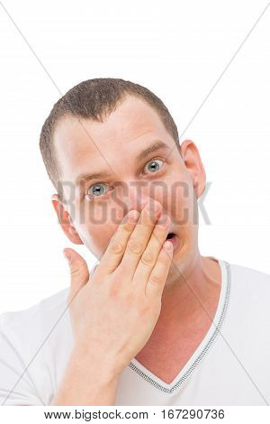 A Young Man Makes A Face, Rubbing His Nose With His Hand Isolated
