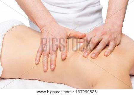 Male Masseur Does Back Massage On A Massage Table