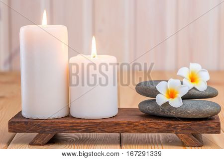 Stones For Massage And Frangipani Flowers In Composition With Candles